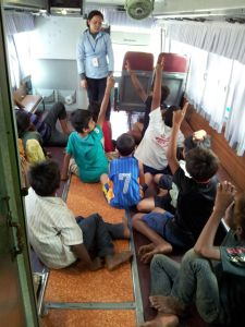 Children learning inside bus